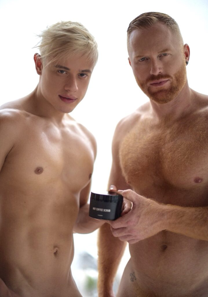 two men holding Hot Coffee Scrub